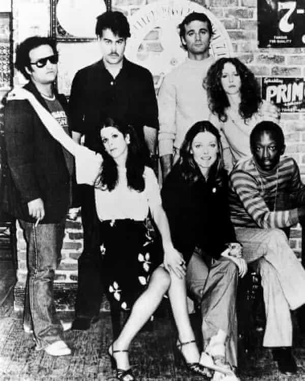 Stars of Saturday Night Live c1977, clockwise from left, Belushi, Dan Aykroyd, Bill Murray, Laraine Newman, Garrett Morris, Jane Curtin and Gilda Radner.