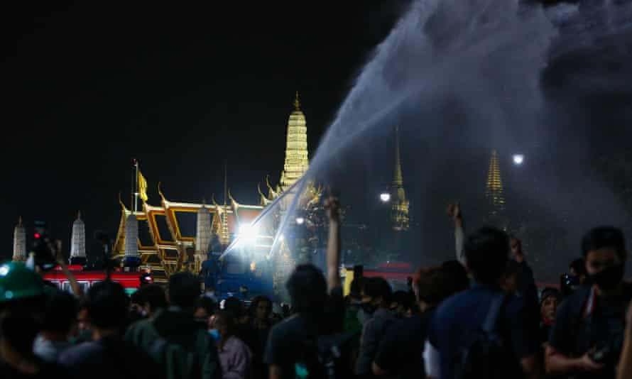 Police fire water cannon at protesters in Bangkok on Sunday.