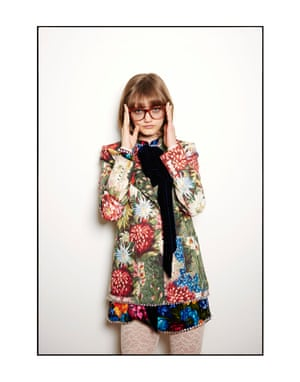 Peyton wears a Gucci jacket, £2,270, dress with bow, £2,600, lace jumpsuit, £530, and glasses, £240