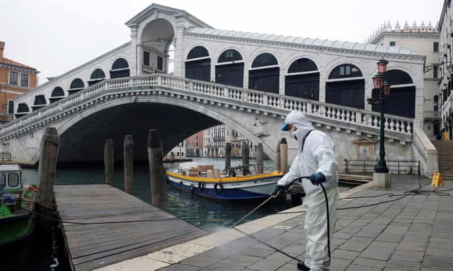 A worker sanitises the Rialto bridge in Venice.