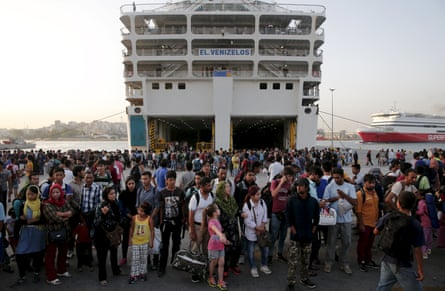 Refugees and migrants escaping the war in Syria wait at Piraeus at the start of the refugee crisis in 2015.