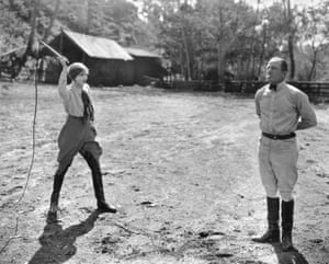 Actress Anna Q. Nilsson prepares to knock a cigarette out of Australian star athlete Snowy Baker's mouth at 15 feet with a bullwhip in March 1925. Baker taught her the stunt and she is said to be the only woman in the US that could do it.