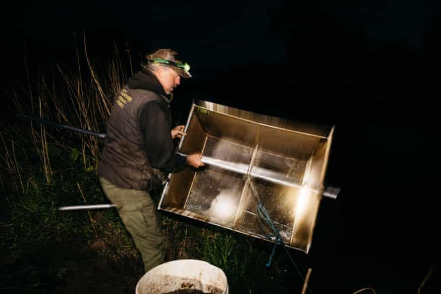 Steve George checks the net for eels