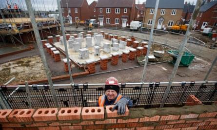 A brickie lays bricks