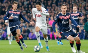 Son Heung-Min bursts between two Red Star defenders