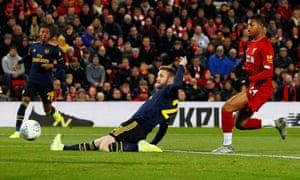 Arsenal's Shkodran Mustafi scores an own goal.