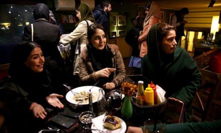 women in a cafe in Tehran