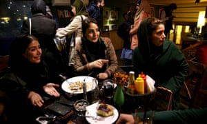 Iranian women at a cafe in central Tehran. Iranians are gearing up for sanctions to be lifted within months.