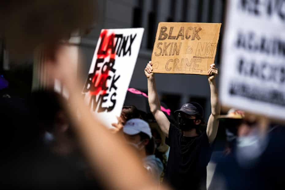 Black Lives Matter protestors gather outside the hall of justice in Los Angeles on 24 June 2020.