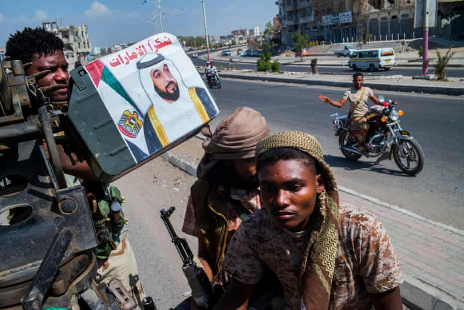 Pro goverment resistance fighters patroling the streets in Aden. their machine guns emblazoned with the picture of the ruker of the UAE. with absence of state institutins militias have become de facto rulers of the city. By Ghaith Abdulahad