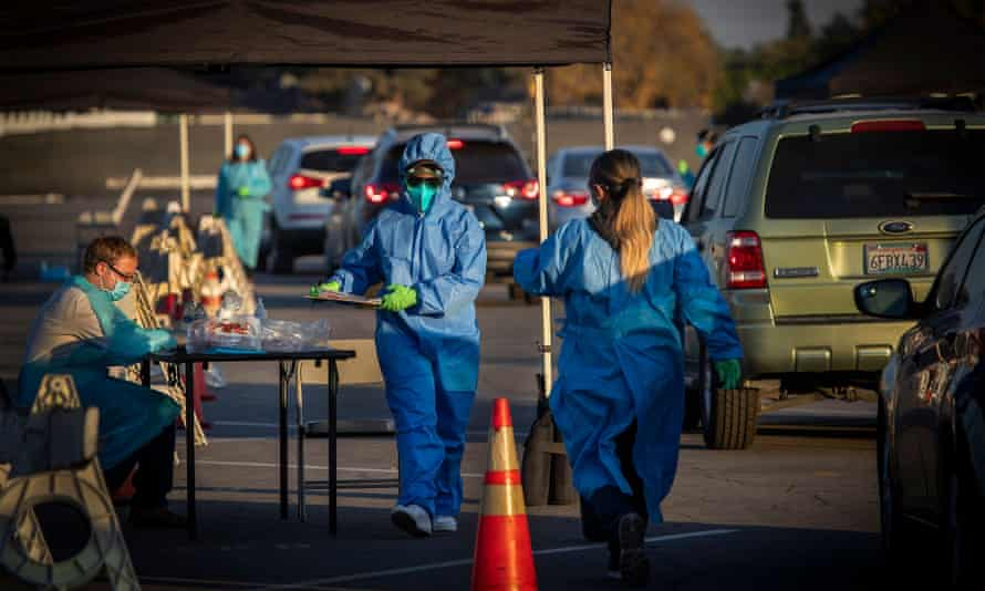 Healthcare workers hand out Covid-19 tests at Long Beach City College-Veterans Memorial Stadium on Wednesday, 9 December 2020.