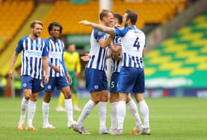 Brighton and Hove Albion's Shane Duffy (right) celebrates victory with teammates.