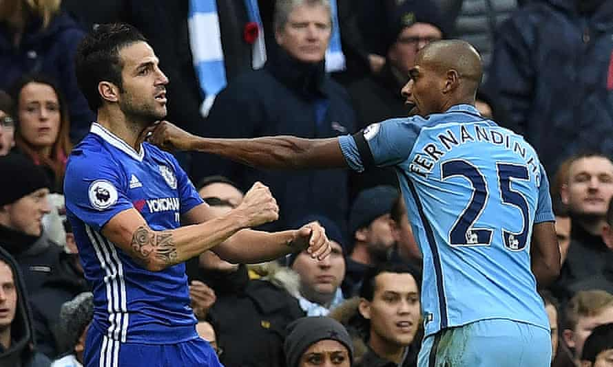 Fernandinho, right, starts to grab and push Chelsea's Cesc Fàbregas, leading to a red card for the Manchester City man