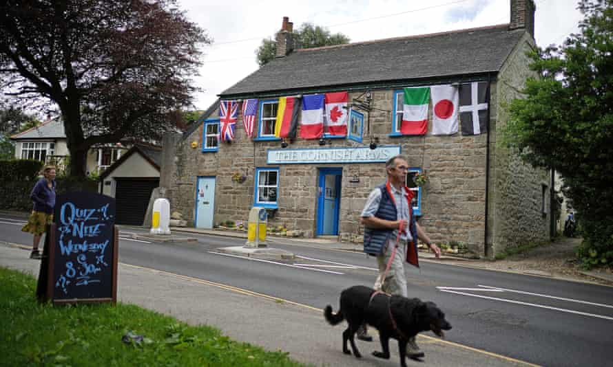 World flags, including the flag of Cornwall (right), decorate the Cornish Arms in St Ives, Cornwall, before the G7 summit.