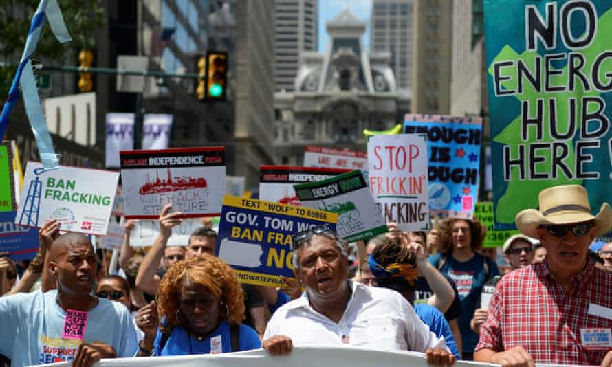 Protesters march in the street ahead of the Democratic national convention in Philadelphia.