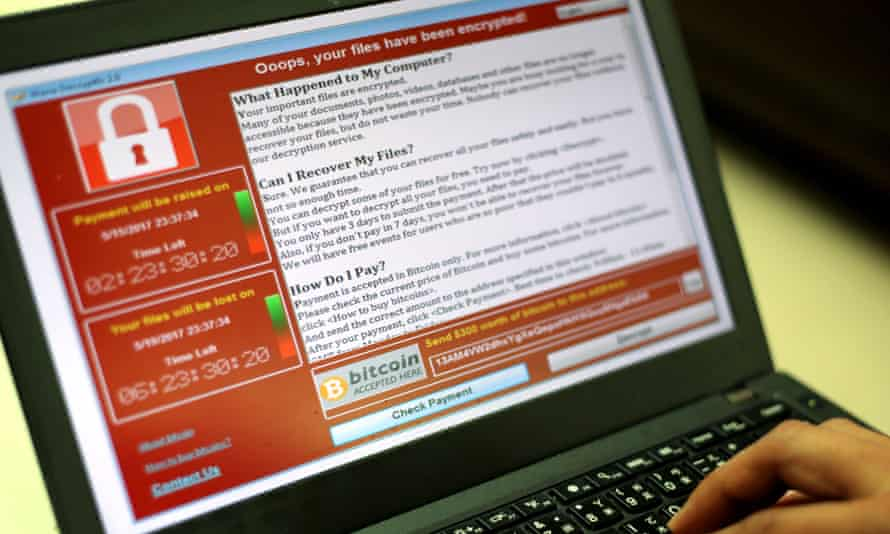 A ransomware cyber-attack is seen on a laptop screen.