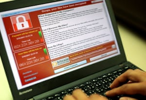 A message demanding payment seen on a laptop after a ransomware cyberattack .