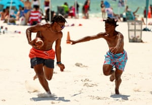 People play on a reopened beach in Clearwater, Florida, US