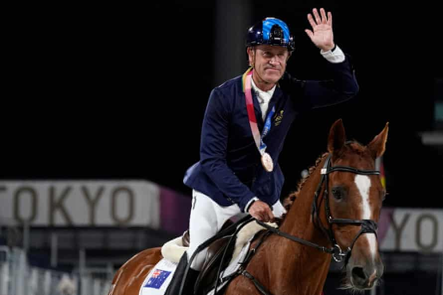 Australia's Andrew Hoy, who first competed at the Olympics in 1984, rides in the ring after receiving his bronze medal.