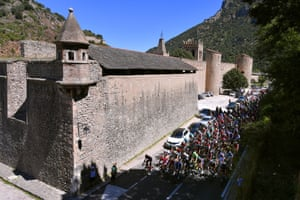 The riders pass through a town on the 158.5km stage 4: Prades Conflent Canigó to Andorra la Vella