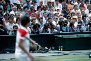 Photographers on Centre Court shoot John McEnroe in 1983