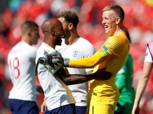 England's Jordan Pickford celebrates with Fabian Delph.