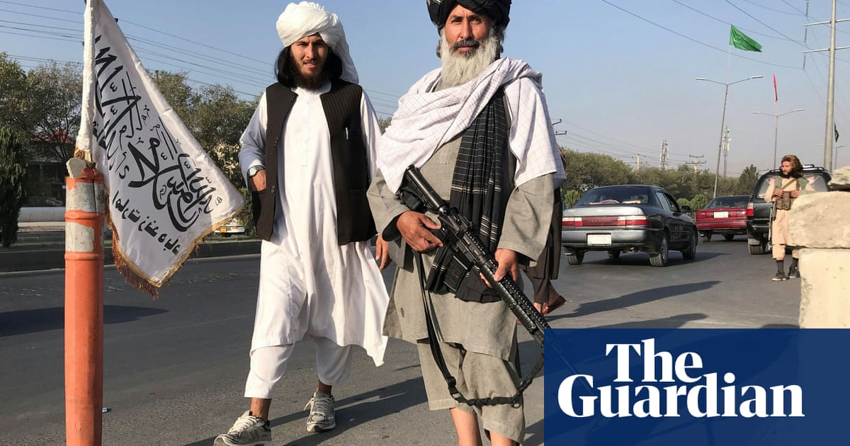 Kabul falls to the Taliban as thousands of Afghans try to flee – video report