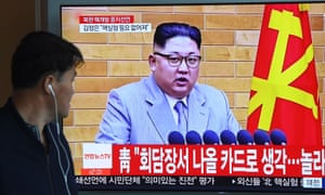 A man watches North Korean leader Kim Jong-un in Seoul on 21 April 2018.