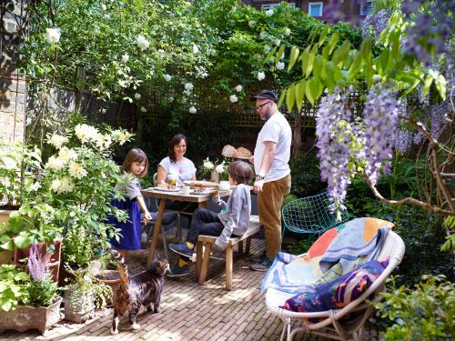 Family sitting round table in garden