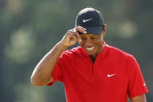 Tiger Woods reacts after finishing on the 18th green