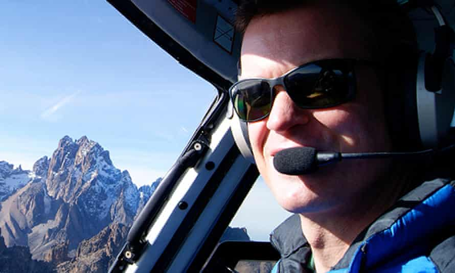 Pilot Roger Gower in helicopter