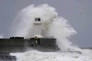 Huge waves crash over the South Gare lighthouse near Redcar, Yorkshire.