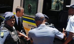 Oscar Pistorius enters a police van after his sentencing at the North Gauteng High Court in Pretoria.