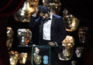 Dev Patel collects his award for best supporting actor for Lion