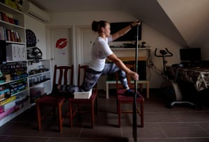 Hungarian canoeist Eda Zsofia Szabo trains on a makeshift vessel at her apartment in Szigethalom.