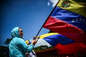 Caracas, VenezuelaAn anti-government activist demonstrates against Venezuelan President Nicolas Maduro at a barricade set up on a road