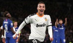Valencia's Rodrigo Moreno celebrates scoring their first goal.