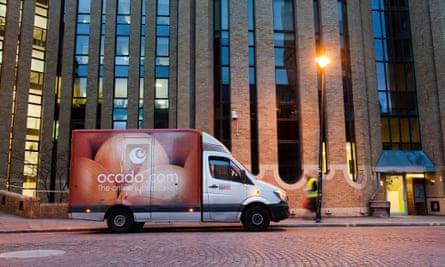 Ocado delivery van outside modern block of flats
