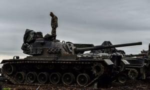 Turkish soldier on a tank