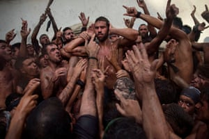 People covered in black grease take part in the traditional festival of the Cascamorras
