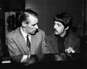 Paul McCartney talking with Martin.