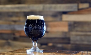 Glass of dark beer on the counter top of Baere Brewing Company, Denver, Colorado