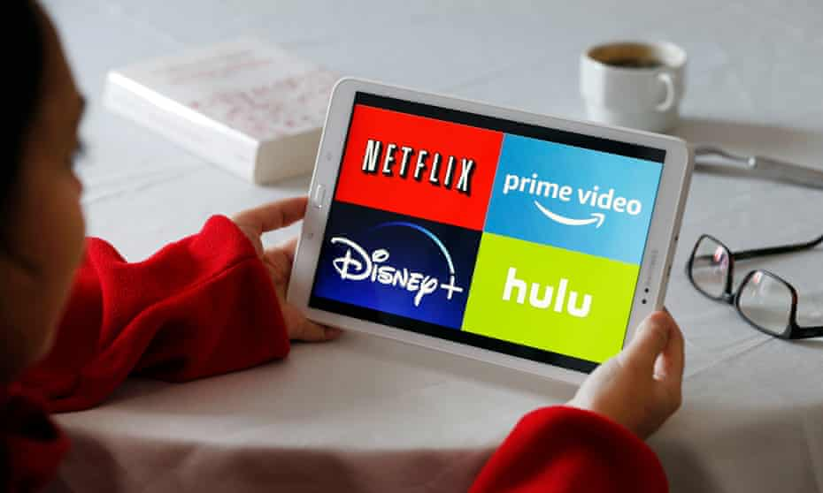 a tablet screen with the logos of disney+, netflix, prime video and hulu