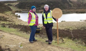 Sue Patchett and fellow toad patroller Malcolm Eldom at Penistone Hill, on the path the runners take close to the pond's edge.