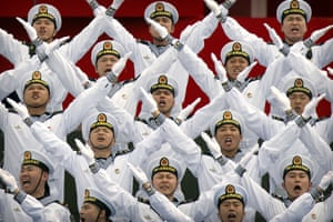 Qingdao, China. A Chinese navy chorus performs during a concert of military bands in Qingdao. Ships from Chinese and foreign navies have gathered in Qingdao for events this week, including a naval parade, to mark the 70th anniversary of the founding of the People's Liberation Army