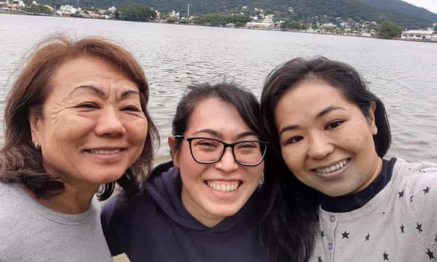 Adriana Midori Takara, centre, with her godmother Kioko Takara, left, and cousin Daniela Sayuri Takara.