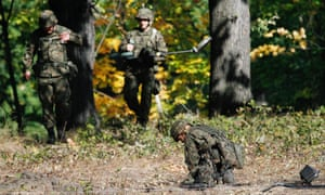 Army experts use mine detectors to check for explosives in an area where a secret tunnel is alleged to be hiding a Nazi train.
