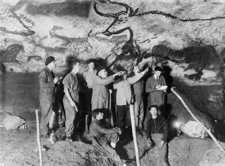 Archaeologist Henri Breuil, third from left at back, in Lascaux cave in 1948.