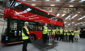 Boris Johnson in front of one of London's revived Routemaster buses, ordered while he was mayor of London, during a visit to the Wrightbus factory.