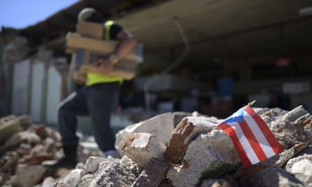 Store owners remove supplies from Ely Mer Mar hardware store, which partially collapsed after an earthquake struck Guanica, Puerto Rico Tuesday.